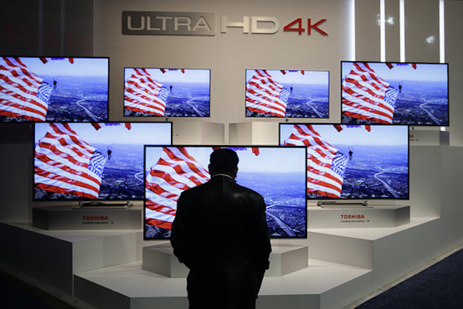 A man looks at Ultra HD 4K displays at the International Consumer Electronics Show in Las Vegas on Jan. 9. Associated Press