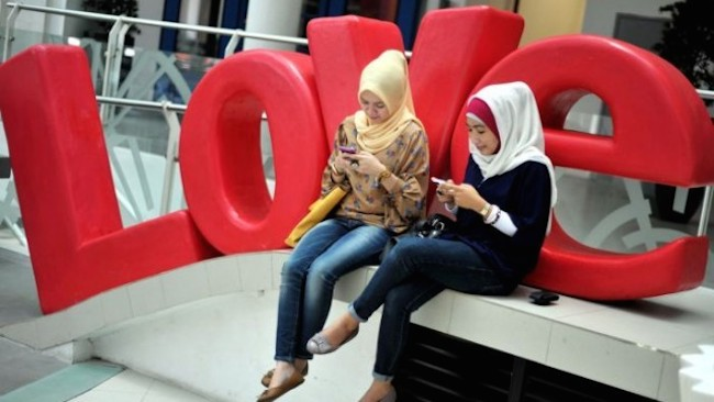In 2012, Jakarta was recognized as the world's most active Twitter city. (Photo source: ABC)