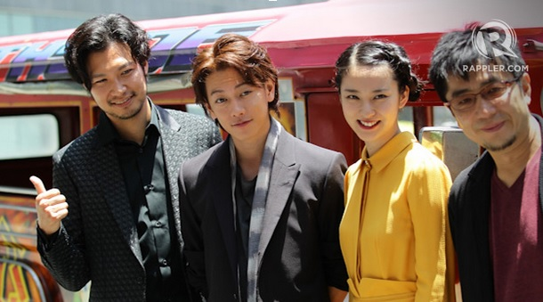 The Cast and Director of Rurouni Kenshin in Manila as they posed for a shoot with a Rurouni Kenshin-themed Jeepney behind them Credits: Rappler