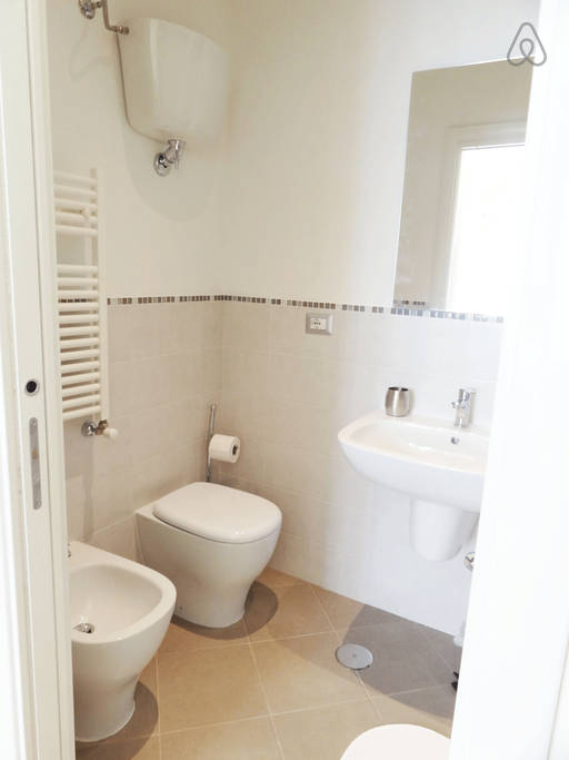 The clean and spacious bathroom even came with a rainshower! Image Credit: Airbnb