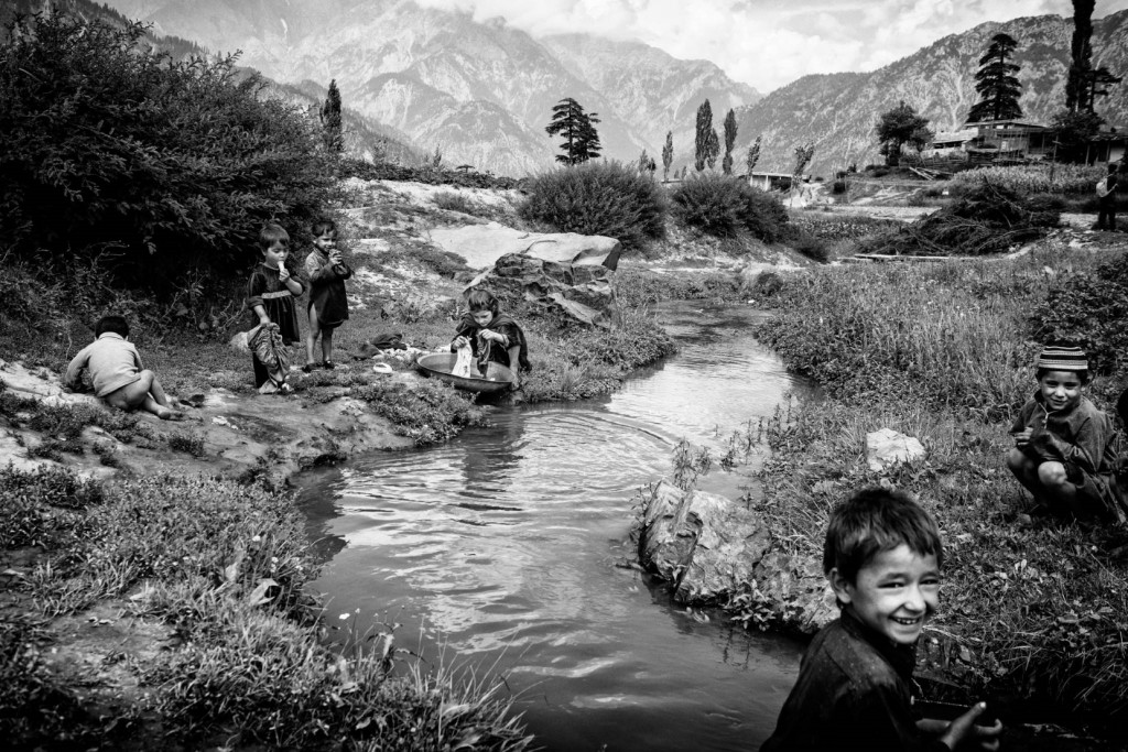 "Children play in a stream in Boyoun village, perched more than a thousand feet above the tourist hub of Kalam town. Away from the main thoroughfare, Boyoun is one of the last vestiges of Swat untouched by conflict and modernity, where children still play traditional games like ""gulidanda"" instead of ""Army versus Taliban"". 2013/08/11. Image Credit: Edwin Koo"