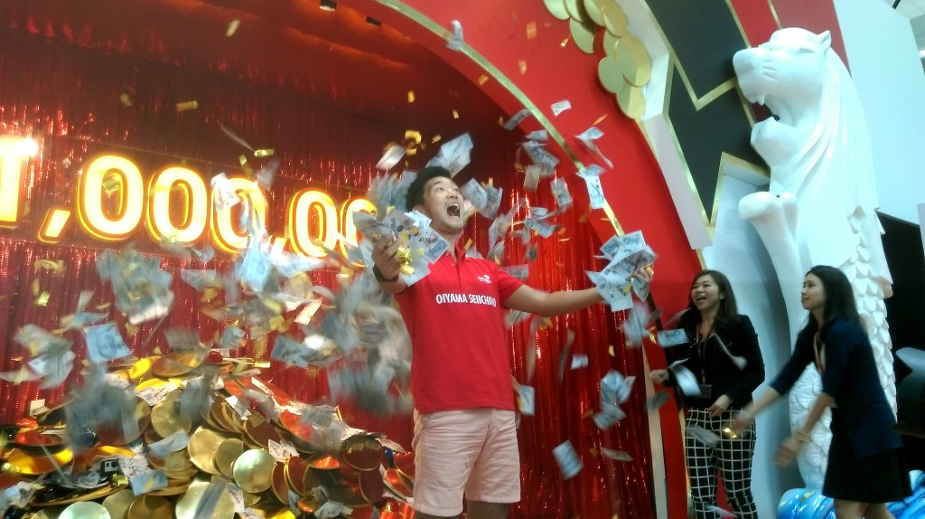 The 'Be a Changi Millionaire' draw winner revealed. Photo: Mohd Azhar