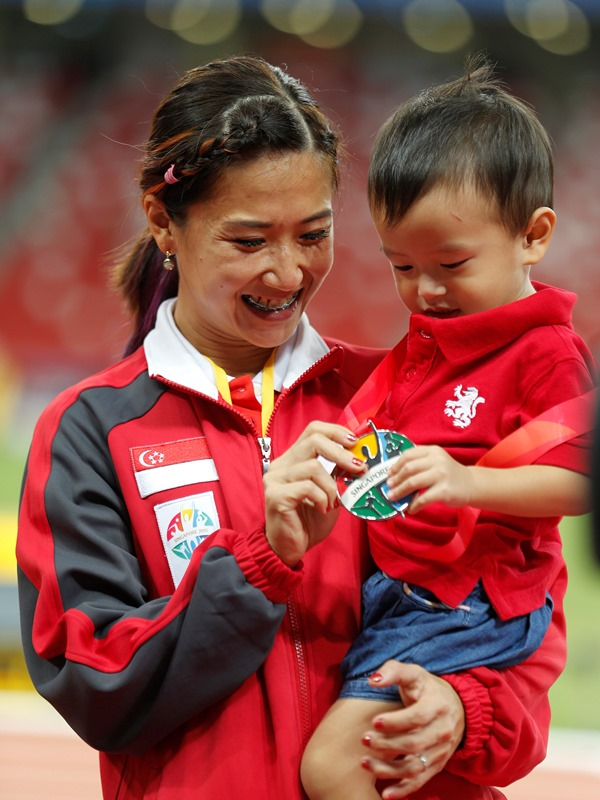 Rachel and her son. (Image Credit: Singapore SEA Games Organising Committee / Action Images via Reuters)