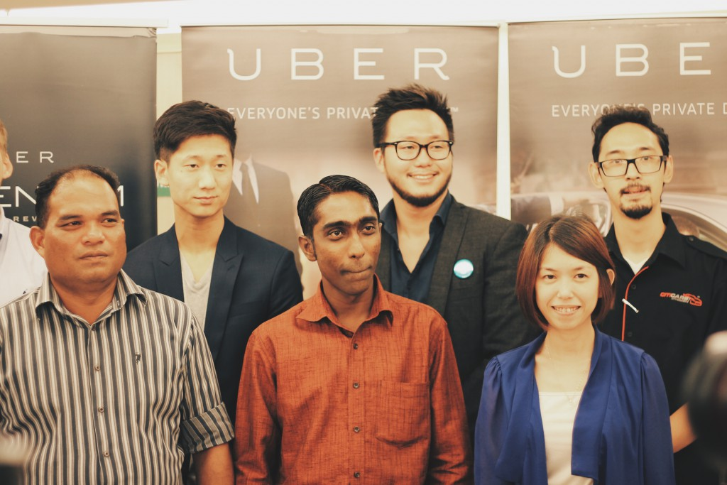 Uber team with their Partner Drivers and their Momentum Rewards Partners at the launch of Momentum in Kuala Lumpur. (Image Credit: