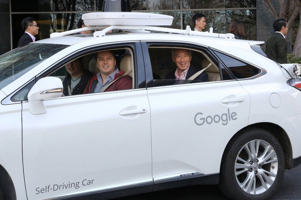 "PM Lee going for a spin in Google's self-driving car. PM: ""It was a very smooth ride"" Image Credit: Facebook"