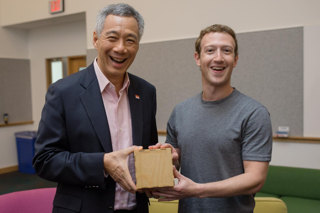 "Mark Zuckerberg: ""It was an honor to host Prime Minister Lee Hsien Loong of Singapore at Facebook HQ today. The Prime Minister is one of the only world leaders who knows how to code. To recognize his technical skills, we gave the PM this artwork designed at Facebook etched with lines from a computer program he wrote. Coding can be useful -- no matter what your job is!"""