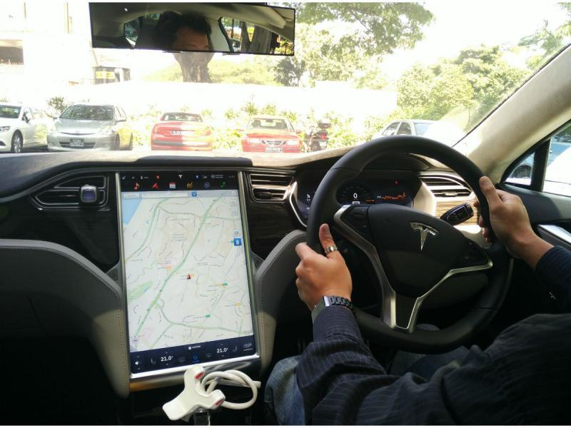 The Only Legal Person To Drive A Tesla In Singapore Here