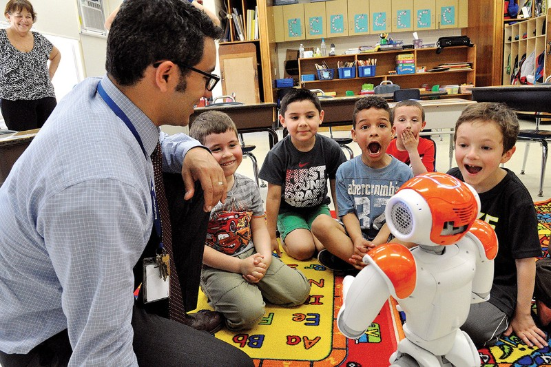 "Social Robot ""NAO"" interacting with children"