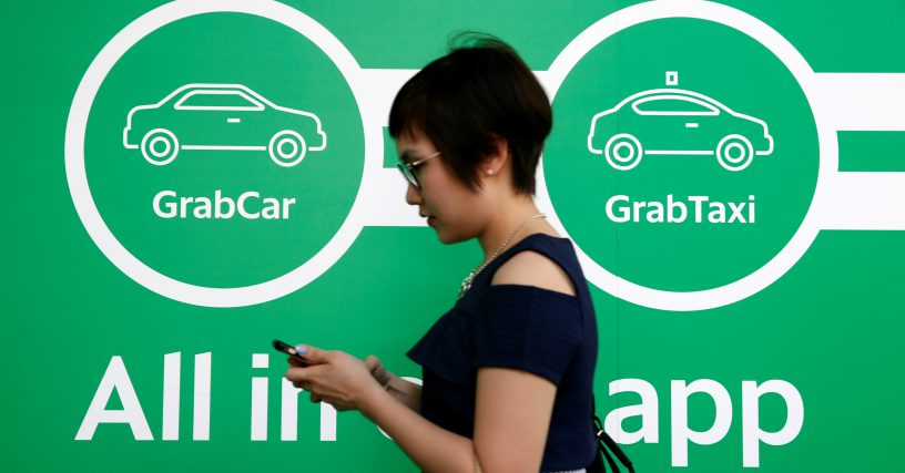 Singapore's Grab raises $2.5 bil. led by SoftBank, Didi Chuxing